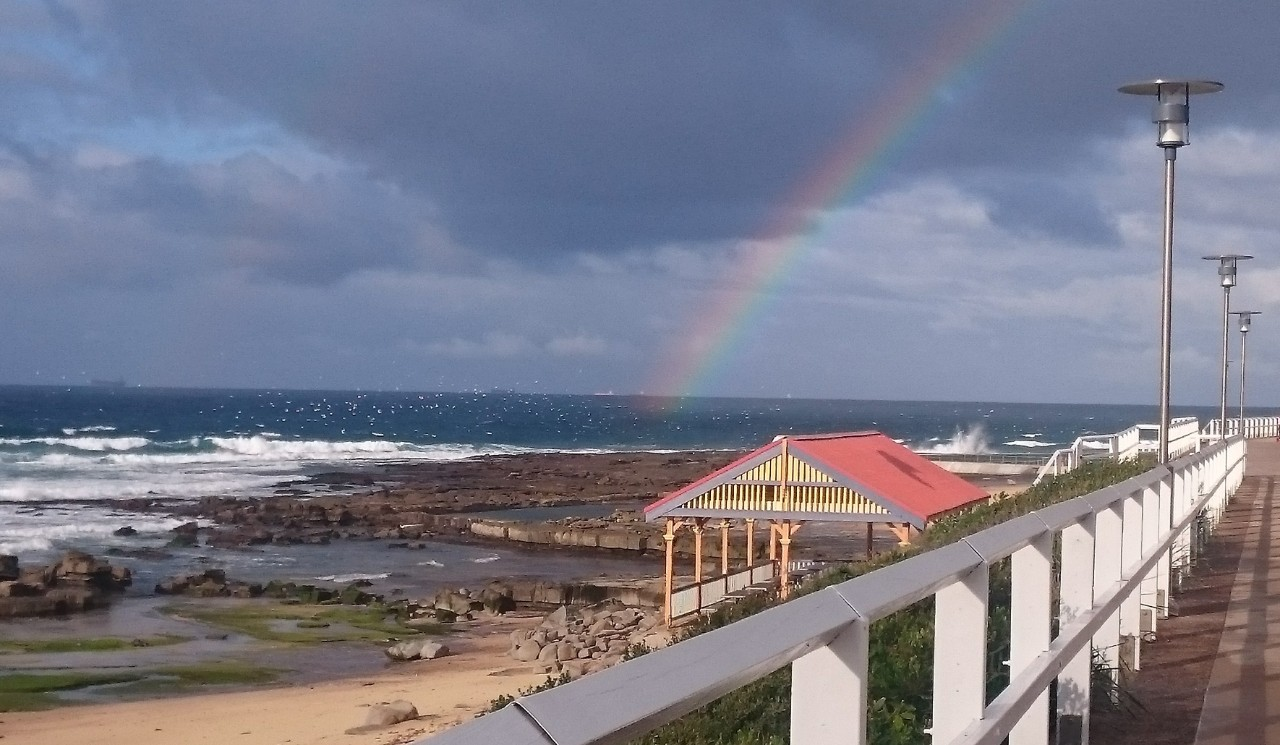 Merewether Beach with rainbow from walkway