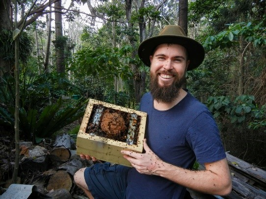 Toby Smith with a native bee hive